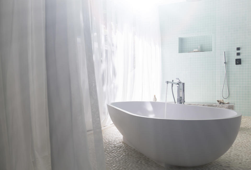 Amazon's best-selling shower liner is mildew resistant, anti-bacterial, and made of PEVA (Photo: Getty Images)