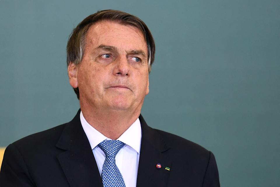 Brazilian President Jair Bolsonaro gestures during the Ceremony for the Modernization of Occupational Health and Safety Regulations at the Planalto Palace in Brasilia, on October 7, 2021. (Photo by EVARISTO SA / AFP) (Photo by EVARISTO SA/AFP via Getty Images)