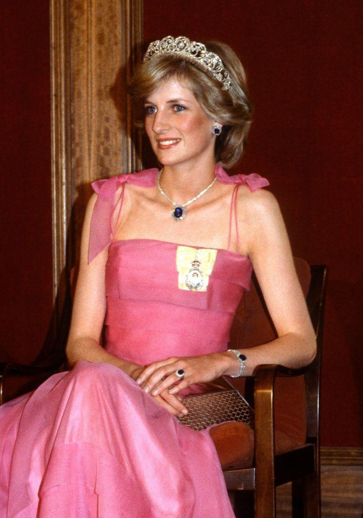 <p>Princess Diana, here at a state reception in Australia in 1983, received a suite of sapphire jewels from the Saudi royal family as a wedding gift, which included a very large Burmese sapphire pendant set on a thin diamond necklace and surrounded by baguette diamonds, matching earrings, a ring (not pictured), a double-row diamond bracelet with a sapphire centerpiece, and a watch featuring seven sapphires (also not pictured).</p>