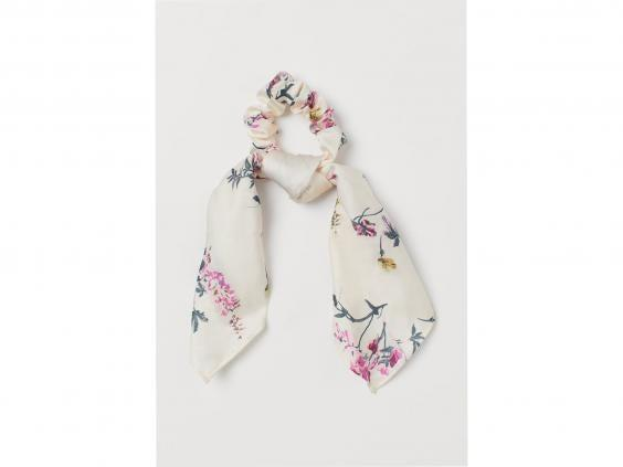 This floral scrunchie reminds us of lush meadows and country walks (H&M)