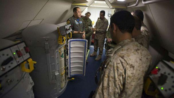 PHOTO: Lt. Fan Yang, left, a tactical coordinator assigned to Patrol Squadron (VP) 5, demonstrates the systems onboard a P-8A Poseidon aircraft to members of the Royal Saudi Naval Forces in an undisclosed location, March 1, 2018.  (U.S. Navy)