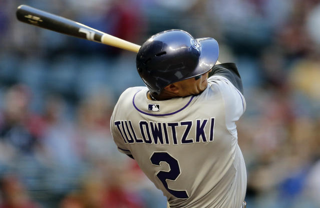 Colorado Rockies' Troy Tulowitzki hits against the Arizona Diamondbacks during the first inning of a baseball game on Wednesday, April 30, 2014, in Phoenix. (AP Photo/Matt York)