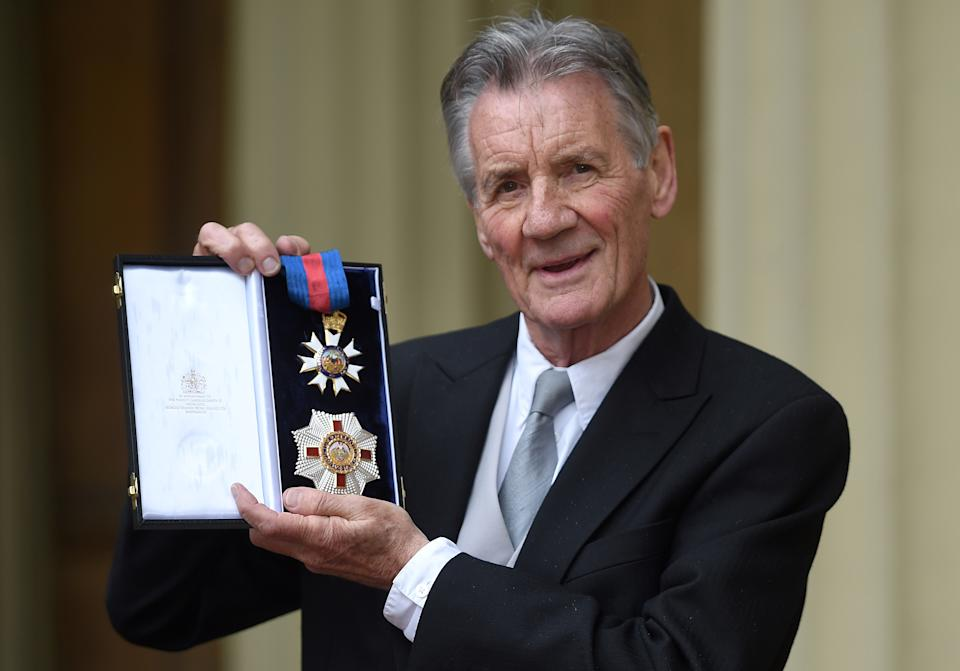 British actor and television presenter Michael Palin poses with his medals after being appointed a Knight Commander of the Order of St Michael and St George (KCMG) during an investiture ceremony at Buckingham Palace in London on June 12, 2019. (Photo by David Mirzoeff / POOL / AFP)        (Photo credit should read DAVID MIRZOEFF/AFP via Getty Images)