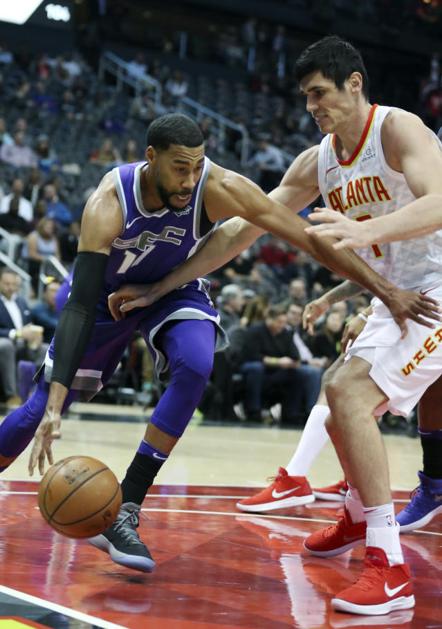Sacramento Kings guard Garrett Temple (17) works against Atlanta Hawks forward Ersan Ilyasova (7) during the first half of an NBA basketball game Wednesday, Nov. 15, 2017, in Atlanta. (AP Photo/John Bazemore)