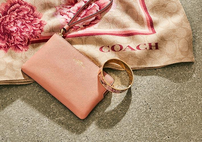 Coach Outlet's latest sale lets you find a gift for them, plus a gift for you. Image via Coach Outlet.