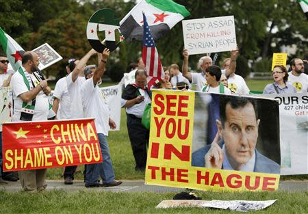A group of Syrian Americans rally in favor of proposed U.S. military action against the Bashar al-Assad regime, outside the U.S. Capitol in Washington, September 9, 2013. REUTERS/Jonathan Ernst