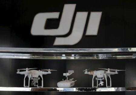 FILE PHOTO: Drones are displayed inside DJI's first flagship store of DJI in Shenzhen