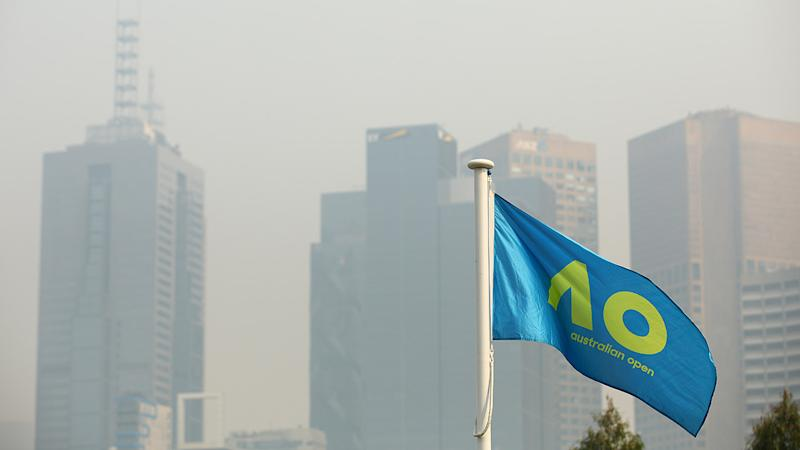 An Australian Open flag, pictured here with the city shrouded in smoke.