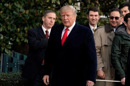 U.S. President Donald Trump looks at  reporters on South Lawn of the White House upon his return in Washington from Pittsburgh, U.S., January 18, 2018. REUTERS/Yuri Gripas