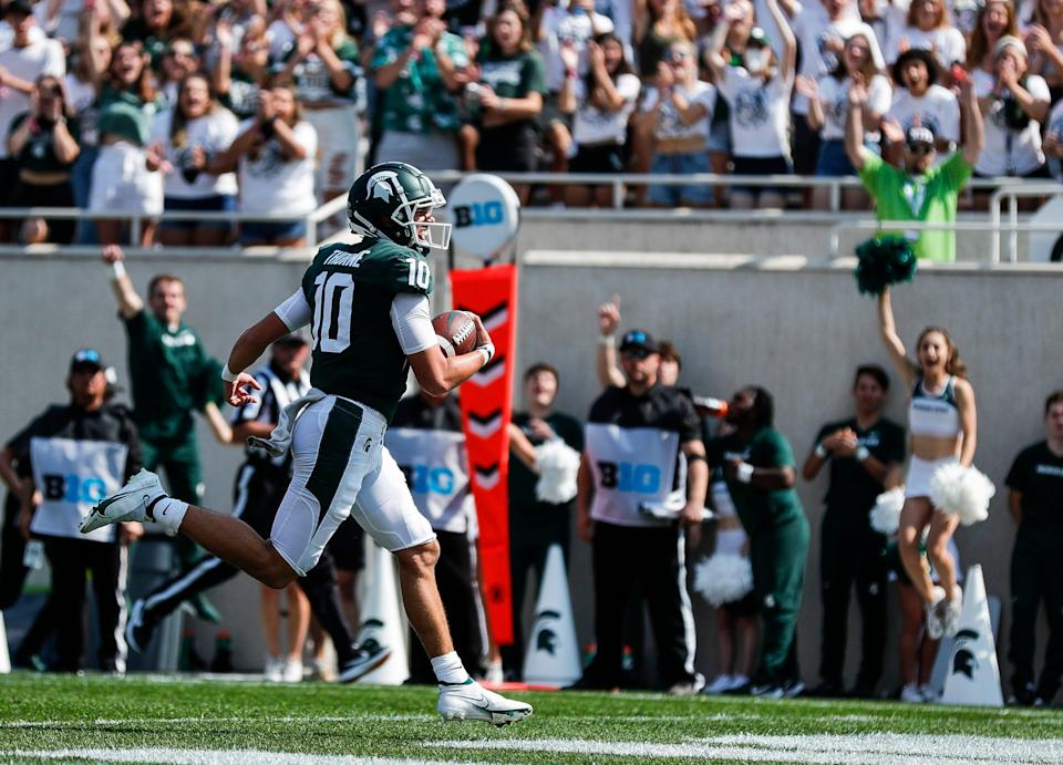 Michigan State quarterback Payton Thorne (10) runs into the end zone for the touchdown against Youngstown State during the first half at Spartan Stadium in East Lansing on Saturday, Sept. 11, 2021.