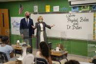 President Joe Biden and first lady Jill Biden talk to students during a visit to Yorktown Elementary School, Monday, May 3, 2021, in Yorktown, Va. (AP Photo/Evan Vucci)