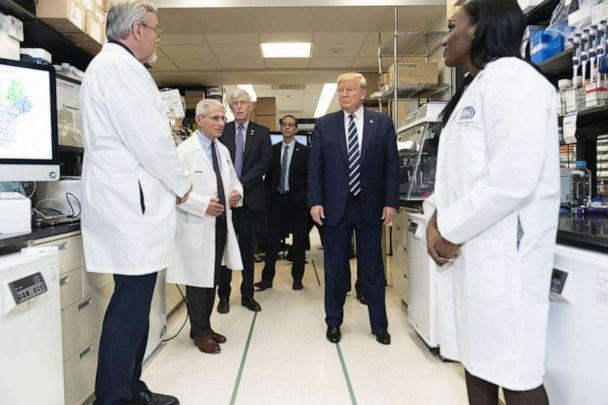 PHOTO: President Trump visits the biological lab, March 3, 2020, at the National Institutes of Health, with Dr. Anthony Fauci, 2nd-left, and Dr. Kizzmekia Corbett, right.  (Shealah Craighead/White House Photo )