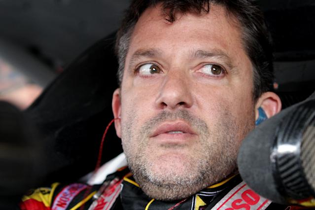 Tony Stewart sits in his car during practice for the NASCAR Sprint Cup Series in Watkins Glen, New York on August 8, 2014 (AFP Photo/Jerry Markland)