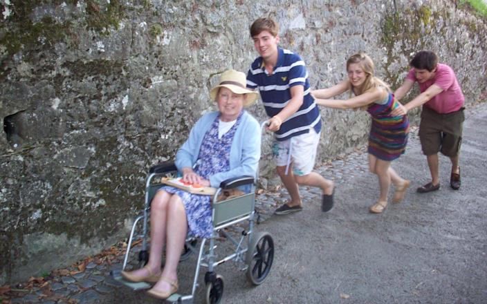 Cancer patient Arabelle Vanneck is pushed by three young members of her family in wheelcahair - Picasa
