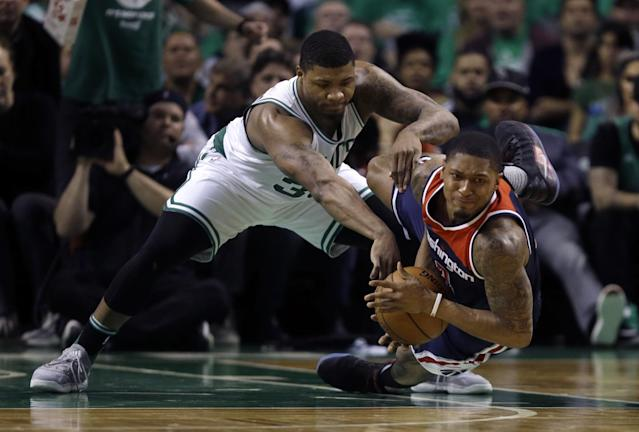 <p>Washington Wizards guard Bradley Beal, right, goes down with the ball as Boston Celtics guard Marcus Smart defends during the second quarter of Game 7 of a second-round NBA basketball playoff series, Monday, May 15, 2017, in Boston. (AP Photo/Charles Krupa) </p>