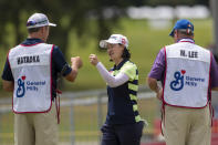 Min Lee reacts on the 18th hole during the first round of the Meijer LPGA Classic golf tournament at the Blythefield Country Club in Belmont, Mich., Thursday, June 17, 2021. (Cory Morse/The Grand Rapids Press via AP)