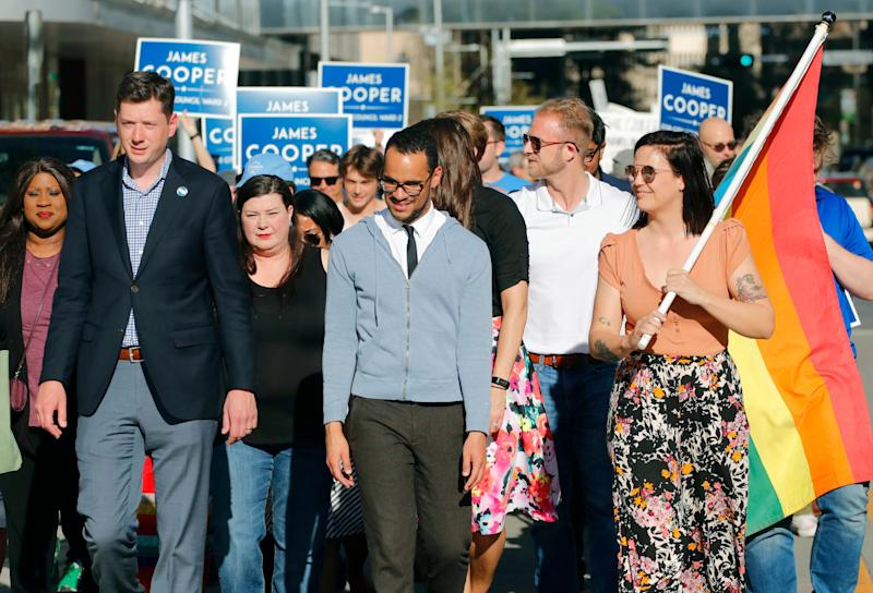 In this Monday, April 8, 2019 photo, Mayor David Holt, left, and Kelley Blair, third from left, CEO and founder of Diversity Center of Oklahoma, walk with Councilman-elect James Cooper, center, and Allie Shinn, Executive Director of Freedom Oklahoma during a march in support of the LGBTQ community, in Oklahoma City, Okla. (Doug Hoke/The Oklahoman via AP)