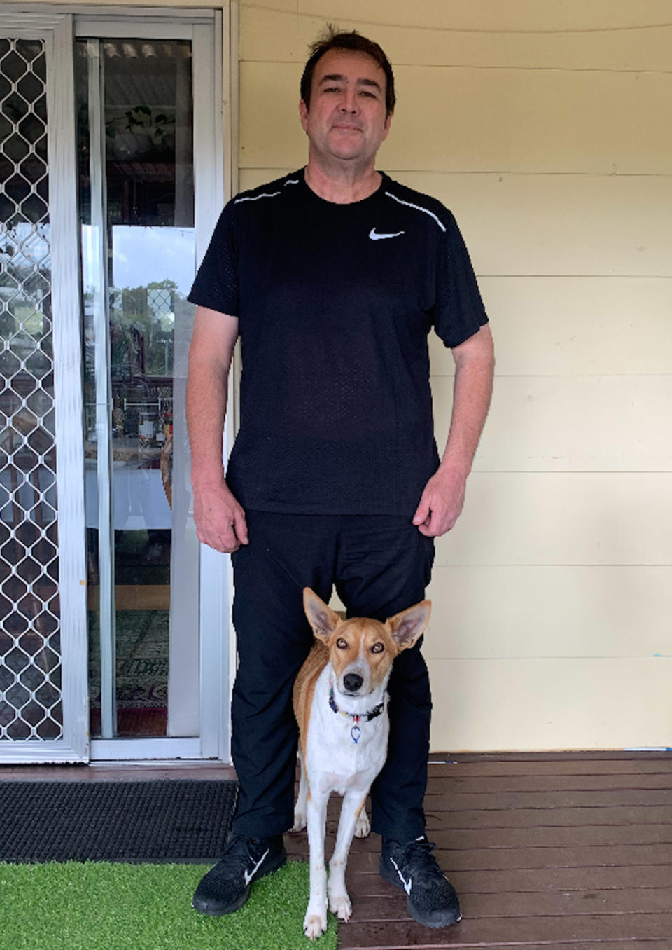 Man who lost weight during coronavirus lockdown standing with his dog