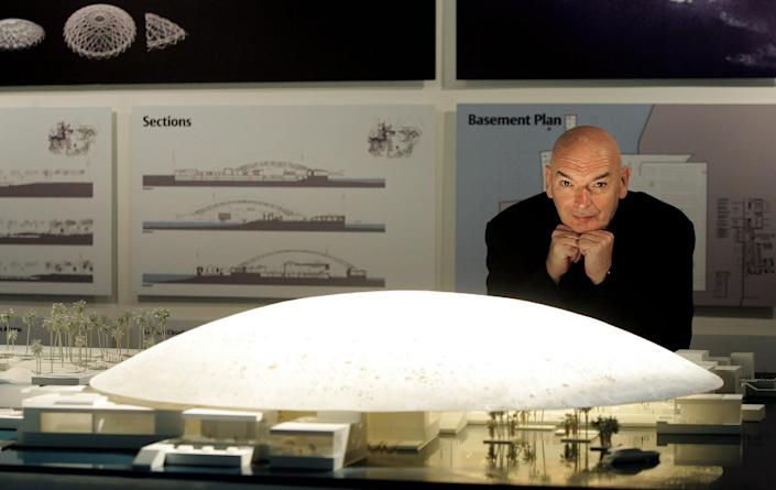 French Architect Jean Nouvel posing in front of a model of the Abu Dhabi Louvre Museum on March 6, 2007 (AFP Photo/Thomas Coex)