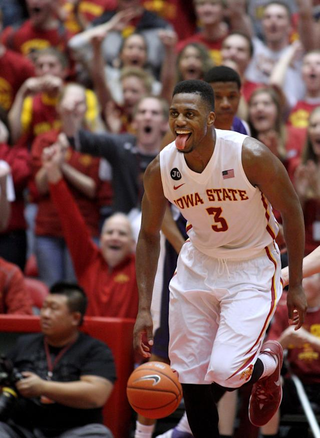 Iowa State forward Melvin Ejim (3) celebrates after a dunk during the second half of an NCAA college basketball game against TCU at Hilton Coliseum in Ames, Iowa, Saturday, Feb. 8, 2014. Ejim scored 48 points and grabbed 18 rebounds as Iowa State won 84-69. (AP Photo/Justin Hayworth)