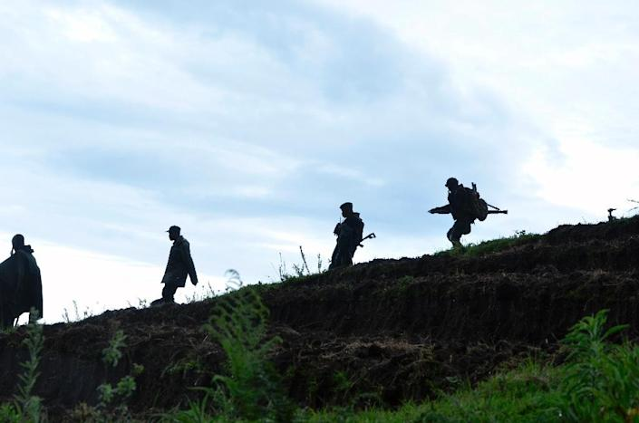 Democratic Republic of Congo Army soldiers are seen advancing in the eastern North Kivu region (AFP Photo/Junior D. Kannah)