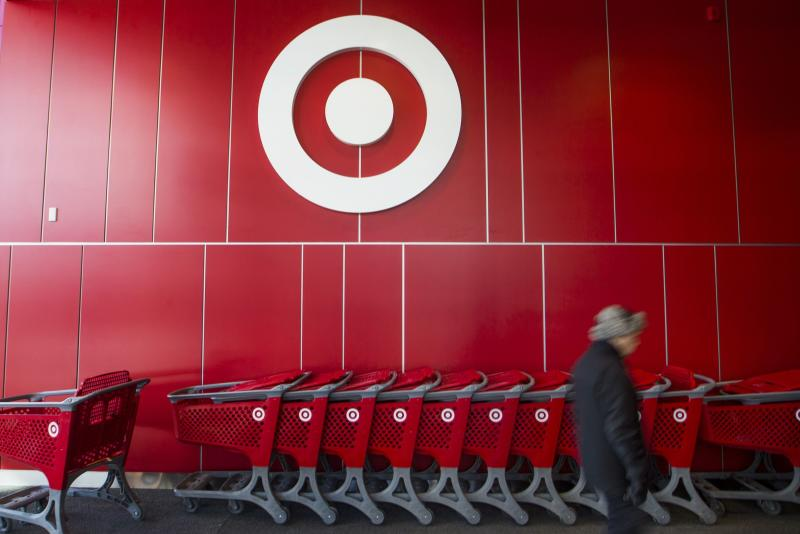 A man walks by shopping carts during the going-out-of-business sale at Target Canada in Toronto