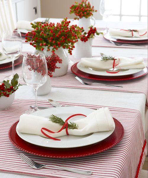 <p>Custom linens don't get simpler than this. Snip and sew red ticking fabric, matching the stripes to cheery chargers and crimson berries. </p>