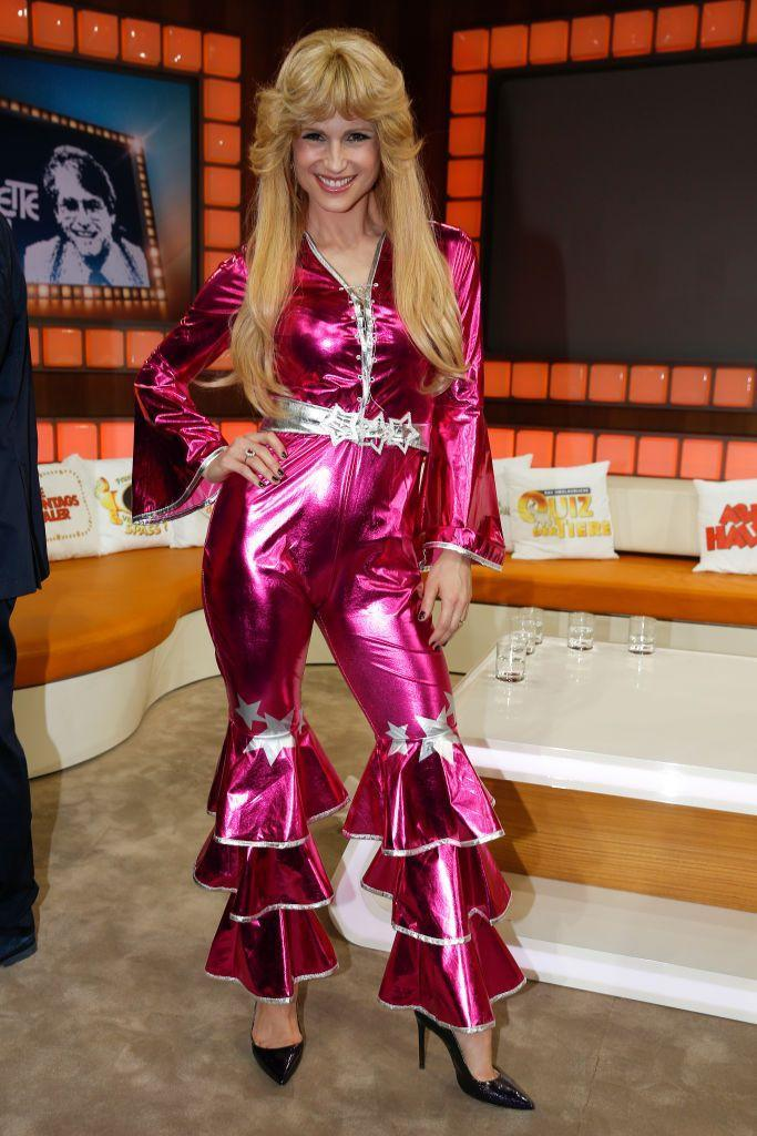 """<p>Become a member of the Swedish band ABBA with a shiny jumpsuit and flipped-out hair. </p><p><a class=""""link rapid-noclick-resp"""" href=""""https://www.amazon.com/Smiffys-Dancing-Costume-Jumpsuit-Serious/dp/B006CK8L1M?tag=syn-yahoo-20&ascsubtag=%5Bartid%7C10070.g.23122163%5Bsrc%7Cyahoo-us"""" rel=""""nofollow noopener"""" target=""""_blank"""" data-ylk=""""slk:SHOP PINK JUMPSUIT"""">SHOP PINK JUMPSUIT</a></p>"""