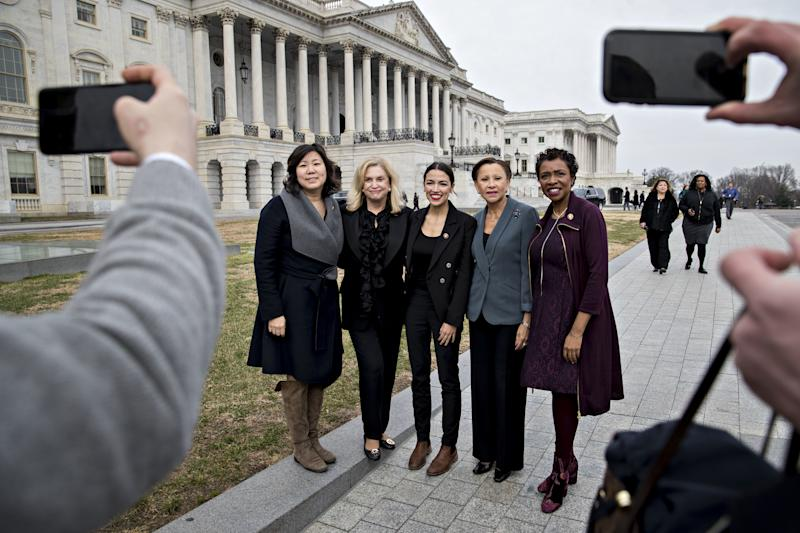 (Left to right) New York Reps. Grace Meng, Carolyn Maloney, Alexandria Ocasio-Cortez, Nydia Velazquez and Yvette Clark, all Democrats, pose for a photograph as Congress convened earlier this month. Ocasio-Cortez, the sole new lawmaker among the group, has proved a magnet for publicity. (Bloomberg via Getty Images)