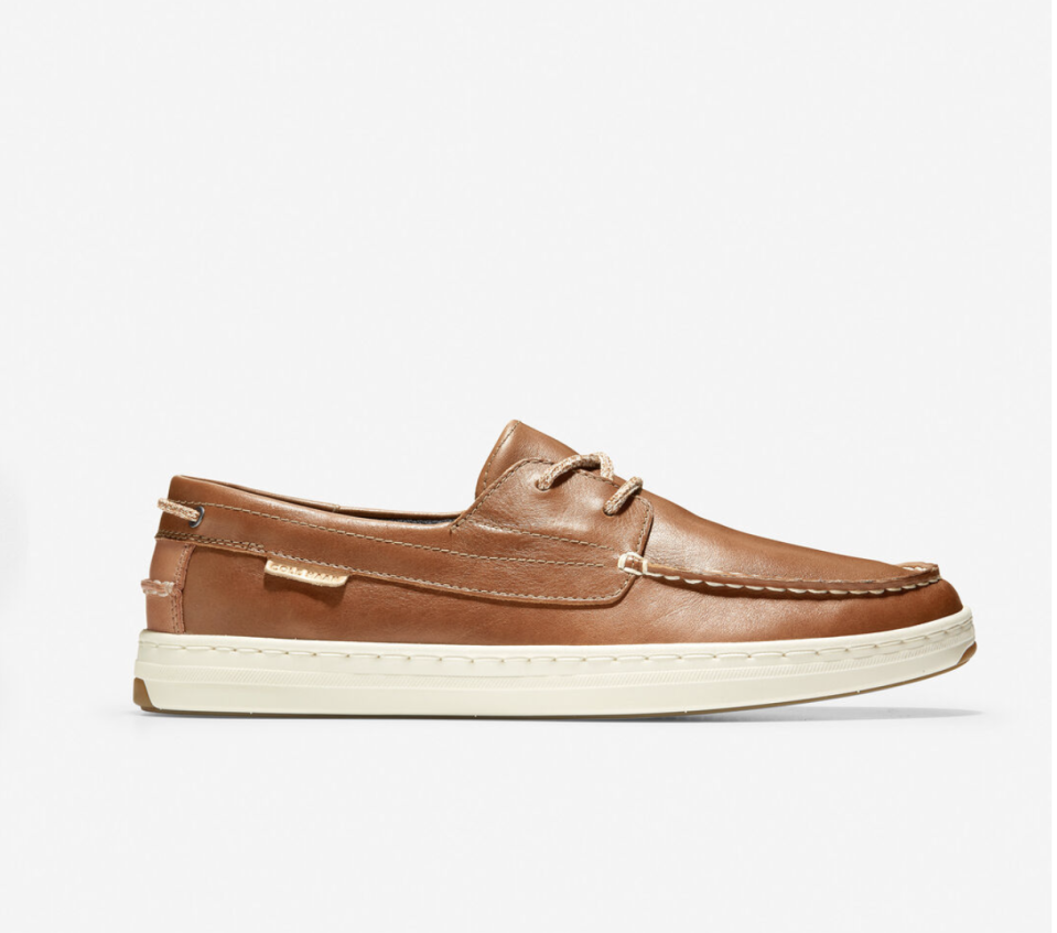 """<p>colehaan.com</p><p><strong>$130.00</strong></p><p><a href=""""https://go.redirectingat.com?id=74968X1596630&url=https%3A%2F%2Fwww.colehaan.com%2Fcloudfeel-boat-shoe-british-tan-leather%2FC32209.html&sref=https%3A%2F%2Fwww.menshealth.com%2Fstyle%2Fg33011338%2Fbest-mens-shoes-standing-all-day%2F"""" rel=""""nofollow noopener"""" target=""""_blank"""" data-ylk=""""slk:BUY IT HERE"""" class=""""link rapid-noclick-resp"""">BUY IT HERE</a></p><p>For a casual, but dressy option, Dr. Cunha suggests these supportive boat shoes. The EVA midolse and Cloudfeel foam provide comfort while the rubber outsole makes them durable. </p>"""