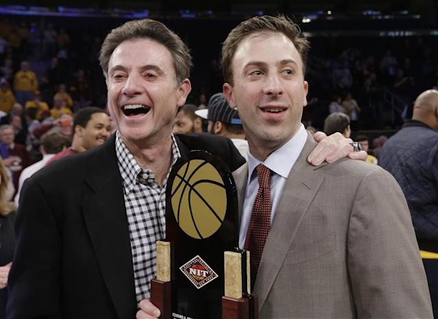 Minnesota coach Richard Pitino, right, stands with his father, Rick Pitino, after Minnesota's 65-63 win over SMU in an NCAA college basketball game in the final of the NIT on Thursday, April 3, 2014, in New York. (AP Photo/Frank Franklin II)