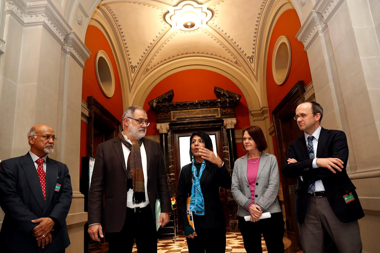Director of Global Bersih Bala Chelliah, Swiss National Councillor Carlo Sommaruga, Director of Center to Combat Corruption and Cronyism Cynthia Gabriel and Director of Bruno Manser Fund Lukas Straumann attend a news conference at the Swiss Parliament Building (Bundeshaus) in Bern, Switzerland March 13, 2018. REUTERS/Stefan Wermuth