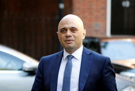 Britain's Chancellor of the Exchequer Javid walks outside 10 Downing Street in London