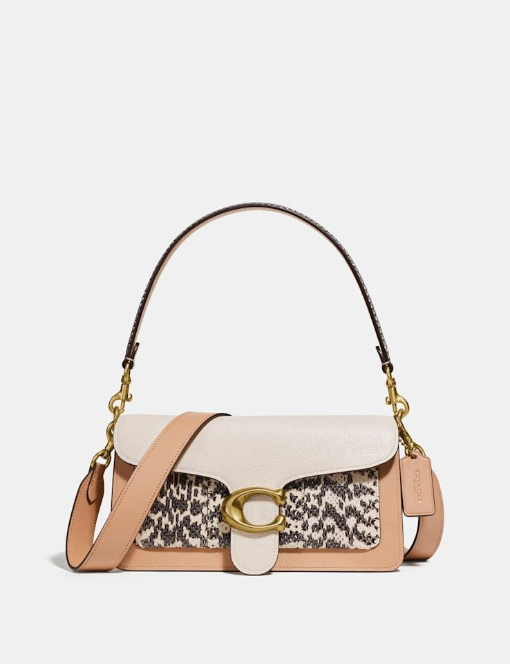 """<p>The print on this <a href=""""https://www.popsugar.com/buy/Coach-Tabby-Shoulder-Bag-486895?p_name=Coach%20Tabby%20Shoulder%20Bag&retailer=coach.com&pid=486895&price=450&evar1=fab%3Aus&evar9=45929069&evar98=https%3A%2F%2Fwww.popsugar.com%2Ffashion%2Fphoto-gallery%2F45929069%2Fimage%2F46573008%2FCoach-Tabby-Shoulder-Bag&list1=shopping%2Ccoach%2Caccessories%2Cbags%2Cshoppping&prop13=mobile&pdata=1"""" rel=""""nofollow"""" data-shoppable-link=""""1"""" target=""""_blank"""" class=""""ga-track"""" data-ga-category=""""Related"""" data-ga-label=""""https://www.coach.com/coach-tabby-shoulder-bag-26-in-colorblock-with-snakeskin-detail/75799.html?cgid=women&amp;dwvar_color=B4L7M"""" data-ga-action=""""In-Line Links"""">Coach Tabby Shoulder Bag </a> ($450) is so cute.</p>"""