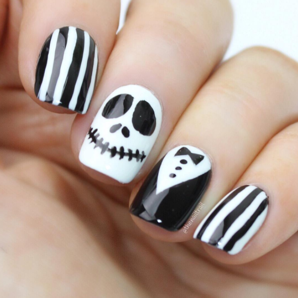 """<p><a rel=""""nofollow"""" href=""""https://www.instagram.com/p/BLbxT7ihc3b/?taken-by=thenailtrail"""">@THENAILTRAIL </a> — If you have ever had a chance to see the '90s film <em>The Nightmare Before Christmas,</em> this will definitely put you in mind of the Pumpkin King character, Jack Skellington. Just perfect for Halloween, right? </p>"""
