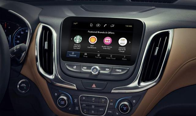 GM's Marketplace app lets you order food, pay for gas and make restaurant reservations from your car's dashboard.