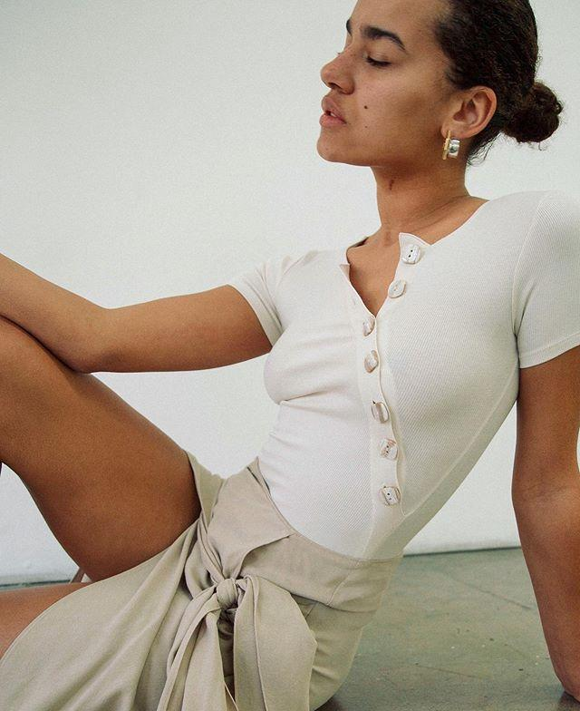 "<p>The Line By K makes basics that aren't. It was founded in 2015 by influencer-turned-designer Karla Deras, offering clean and sleek clothing that could easily be dressed up or worn alone for that effortless fashion girl look. </p><p><a class=""body-btn-link"" href=""https://www.thelinebyk.com/"" target=""_blank"">shop to support</a></p><p><a href=""https://www.instagram.com/p/B94gv_QpZR6/"">See the original post on Instagram</a></p>"