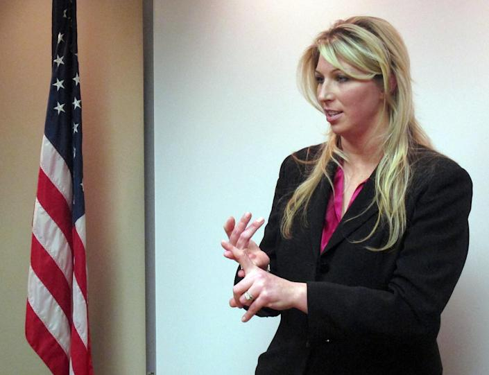 FILE - In this file photo taken Dec. 4, 2012, in Anchorage, Alaska, Anchorage police Detective Monique Doll speaks at a news conference after confessed serial killer Israel Keyes committed suicide at the Anchorage jail. Keyes showed no remorse as he detailed how he'd abducted and killed an 18-year-old woman, then demanded ransom, pretending she was alive. His confession cracked the case, but prosecutors questioning him soon realized there was more, he has killed before. Before divulging more details, Keyes committed suicide in his cell. (AP Photo/Mark Thiessen)