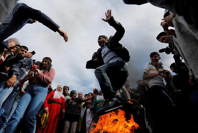 A man jumps over a bonfire during a gathering to celebrate Newroz, which marks the arrival of spring and the new year, in Istanbul, Turkey March 21, 2018. REUTERS/Murad Sezer TPX IMAGES OF THE DAY