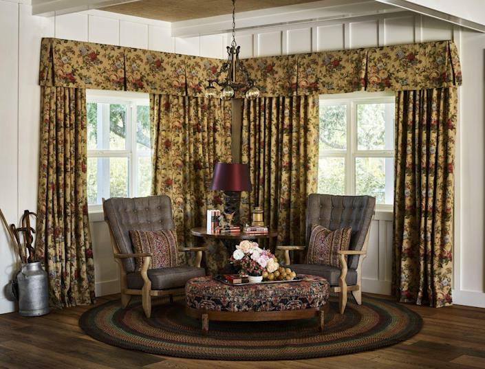 """<p><a href=""""https://www.veranda.com/home-decorators/a36082847/curtain-ideas/"""" rel=""""nofollow noopener"""" target=""""_blank"""" data-ylk=""""slk:Lavish curtains"""" class=""""link rapid-noclick-resp"""">Lavish curtains</a> with all the trimmings are back and ready to put some glitz into your decorating scheme. For this <a href=""""https://www.veranda.com/decorating-ideas/house-tours/a33487560/ken-fulk-healdsburg-california-estate-house-tour/"""" rel=""""nofollow noopener"""" target=""""_blank"""" data-ylk=""""slk:California vineyard estate"""" class=""""link rapid-noclick-resp"""">California vineyard estate</a>, designer <a href=""""https://shop.kenfulk.com/"""" rel=""""nofollow noopener"""" target=""""_blank"""" data-ylk=""""slk:Ken Fulk"""" class=""""link rapid-noclick-resp"""">Ken Fulk</a> used floral drapery fabric to define a reading nook within the much larger living room. Guillerme et Chambron designed the pair of French Grand Repos lounge chairs (<a href=""""https://www.votremaison.fr/"""" rel=""""nofollow noopener"""" target=""""_blank"""" data-ylk=""""slk:Votre Maison"""" class=""""link rapid-noclick-resp"""">Votre Maison</a>).</p>"""