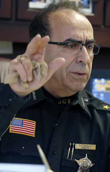 Jefferson County Sheriff Fred Abdalla talks about how the FBI is investigating cyber threats in the eastern Ohio city that includse a death threat received by the sheriff in his office on Wednesday, Jan. 9, 2013, in Steubenville, Ohio. (AP Photo/Keith Srakocic)