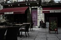 A man sits at an empty terrasse of a cafe in Bordeaux before a new Covid-19 lockdown comes into effect.