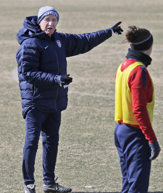 "In this photo taken on Tuesday, Jan. 28, 2014, U.S. women's soccer head coach Tom Sermanni, left, speaks to Carli Lloyd during team practice in Frisco, Texas. Sermanni found out what a unique job it is to be coach of the top-ranked U.S. women's soccer team. Now he's headed into his second year, one in which he is looking for performance and results into World Cup qualifying after a year of what he called ""assessment and opportunity.'' (AP Photo/LM Otero,Pool)"