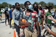 Haitian migrants queue to get food at a shelter in Ciudad Acuna, Mexico, across the border from Del Rio, Texas, where many have traveled hoping to remain in the United States (AFP/PEDRO PARDO)