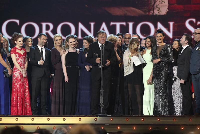 The cast and crew of Coronation Street accept the award for Best Serial Drama on stage during the 2014 National Television Awards at the O2 Arena, London. (Photo by Yui Mok/PA Images via Getty Images)