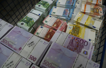 Wads Of Euro Banknotes Are Stacked In A Pile At The Money Service Austria Company