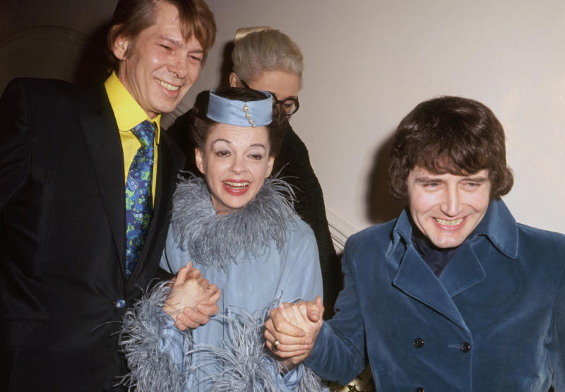 American entertainer Judy Garland and New York businessman Mickey Deans (r) after their wedding at Chelsea Register Office, London. With them (l) is singer Johnny Ray who was the best man.
