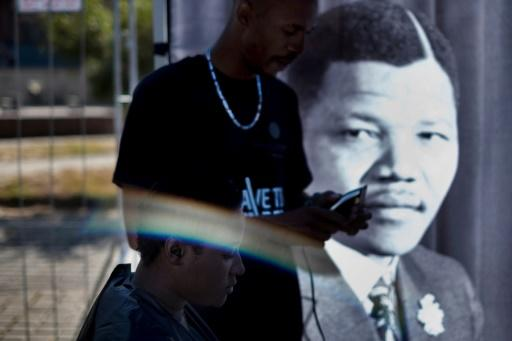 A youth has his haircut as part of the centenary celebrations of the birth of South Africa's first black president Nelson Mandela