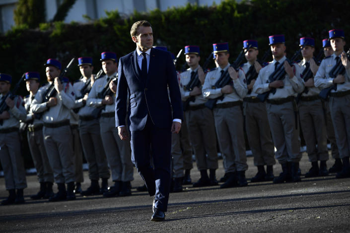 French President Emmanuel Macron reviews troops as he pays tribute to French soldiers who died in Mali helicopter crash, Monday Jan.13, 2020 in Pau, southwestern France. France is preparing its military to better target Islamic extremists in a West African region that has seen a surge of deadly violence. (AP Photo/Alvaro Barrientos, Pool)