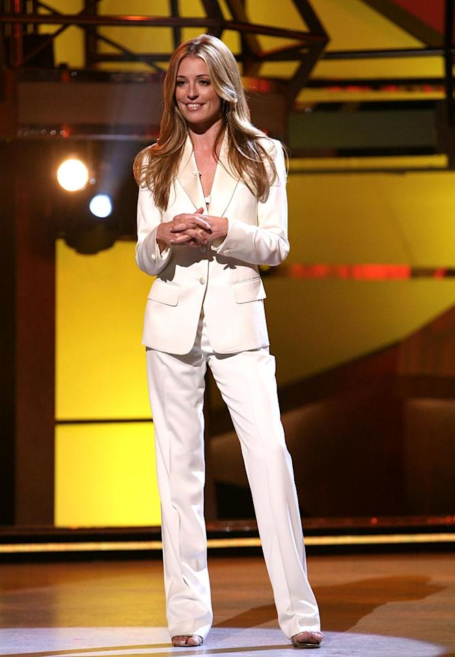 "Cat Deeley wore a sleek white  Yves Saint Laurent ""le smoking"" suit to keep with the theme of the results night's group number with the Top 18 ""So You Think You Can Dance"" contestants."